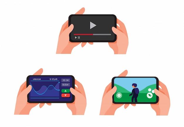スマートフォンのプレイを持っている手し、オンラインでビデオストリーミングを見て、株式アプリを市場に出し、シューティングゲームコレクションをプレイイラストセットを再生