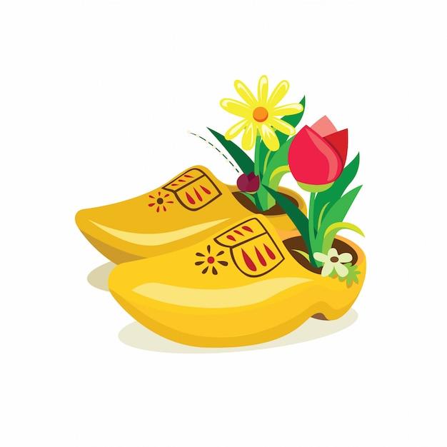 オランダの下駄、チューリップの花の装飾とオランダからの伝統的な木製の靴のリアルなイラスト