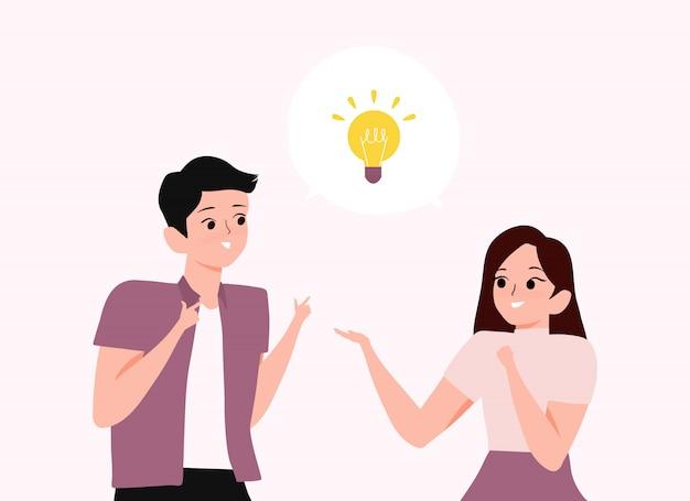 若い男性と女性がアイデアを持ち、話し合っています。若者が吹き出しの電球アイコンで解決策または問題解決を持っている