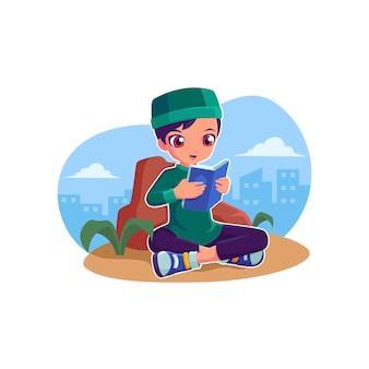 イスラム教徒の少年がアルコーランのラマダンイラストを読む