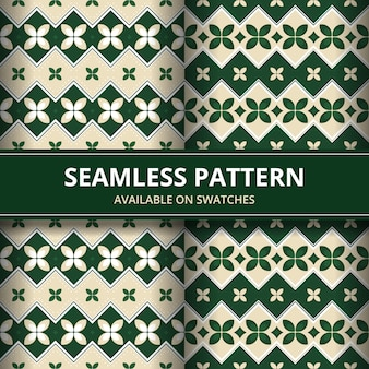 Традиционный батик бесшовные узор фона классические обои. элегантная геометрическая форма. роскошный этнический фон в зеленом цвете