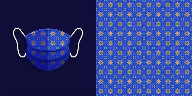 バティックのシームレスなパターン背景セットを持つ医療マスク