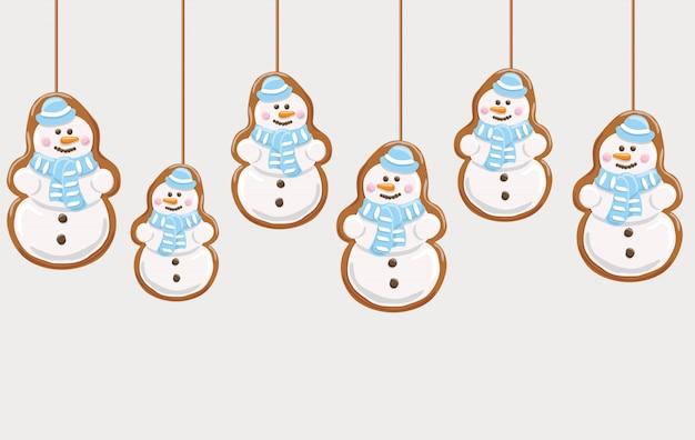 ジンジャーブレッドの雪だるまクッキーを吊るす