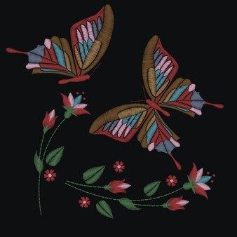 暗い背景に蝶と花のコレクションを設定
