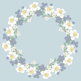青い背景の花の丸いフレーム。スプリングデザイン