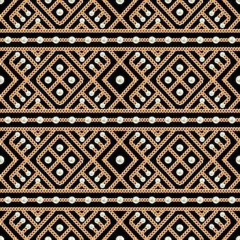 ゴールドチェーン飾りと黒の背景に真珠のシームレスパターン