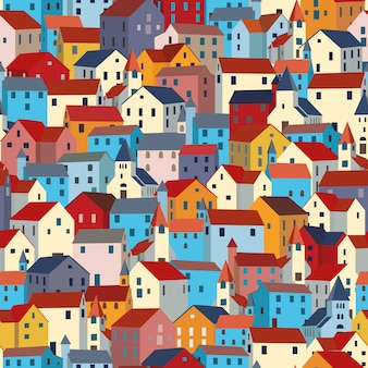 明るくカラフルな家とのシームレスなパターン。市や町のテクスチャです。