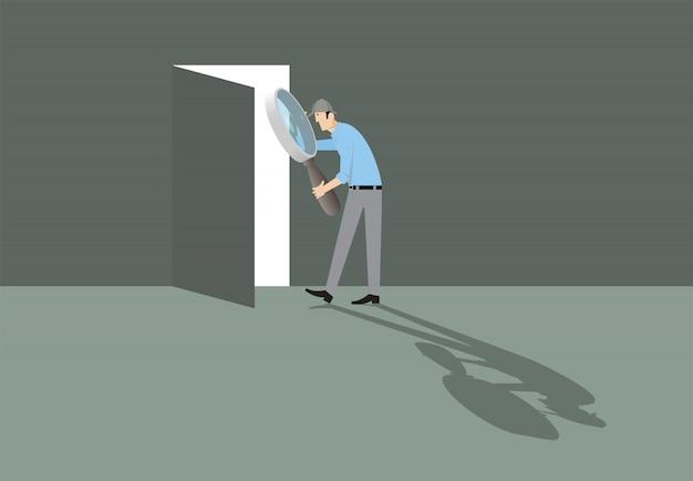 エスケープルームのコンセプト。方法への扉を見つける虫眼鏡を持つ男。