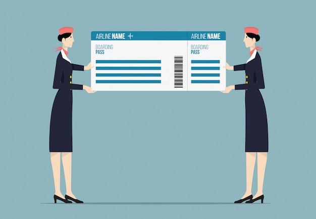 大きな搭乗券を持っている航空会社のホステス。
