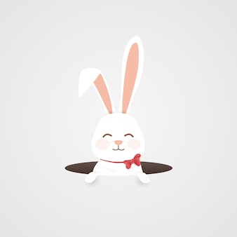 穴にウサギとハッピーイースターの背景
