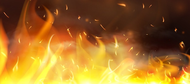 赤い火の火花が舞い上がる。燃える光る粒子。暗い夜の空中火花と火の炎。黒の透明な背景に分離されました。