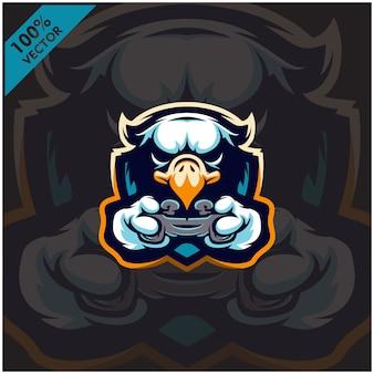 Игл геймер держит игровую приставку джойстик. дизайн логотипа талисмана для команды киберспорта.