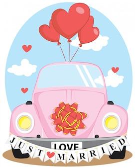 愛の風船とちょうど結婚した結婚式の車