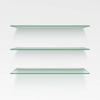 壁の背景に空のガラス棚の棚