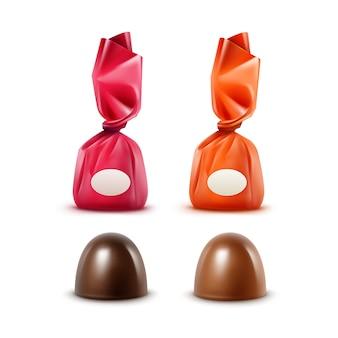 色の赤、オレンジ、濃いピンクの光沢のある箔ラッパーで現実的なダークブラックビターミルクチョコレートキャンディーのセットをクローズアップで孤立した白い背景