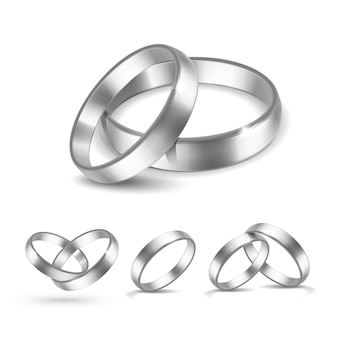 白い背景で隔離の銀の結婚指輪のセット