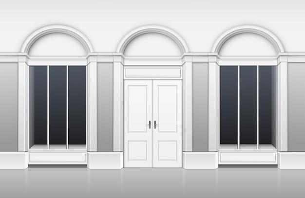 ガラスのショーケース、ドアを閉めて、白い背景で隔離の名前のための場所でクラシックショップブティックビルディングストアフロント