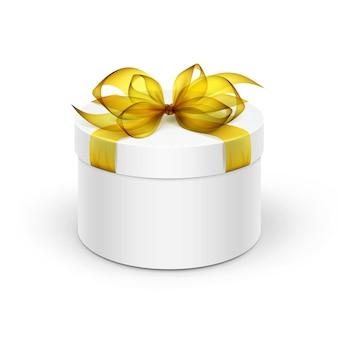 黄色いリボンと弓の背景に分離された白い丸いギフトボックス