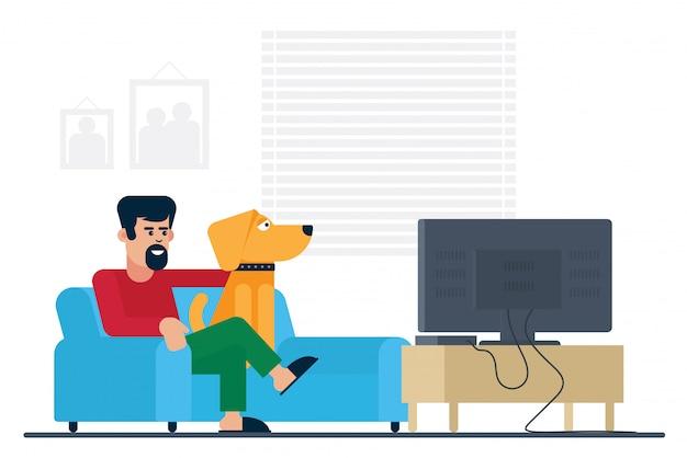 家でテレビを見ています。犬のイラストを持つ男