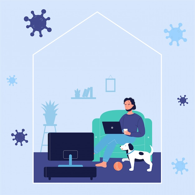 Молодой человек отдыхает на диване и работает онлайн с ноутбуком дома с собакой во время коронавируса