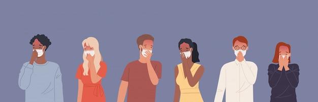 マスクをして咳をする人。