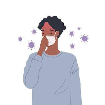 ウイルスは空気中に広がります。マスクを着用し、咳をする男性。