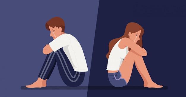 孤独な男と女が床に座って泣きながら、うつ病や人間関係の崩壊に苦しんでいます。