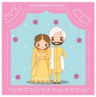 伝統的なウェディングドレスのかわいいインディアンカップル