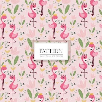 ピンクの花とフラミンゴの鳥のシームレスパターン
