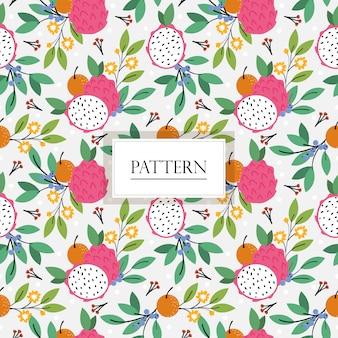 ドラゴンフルーツ、オレンジ、ブルーベリー、花のシームレスパターン