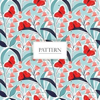 ユリの谷の花と蝶のシームレスパターン