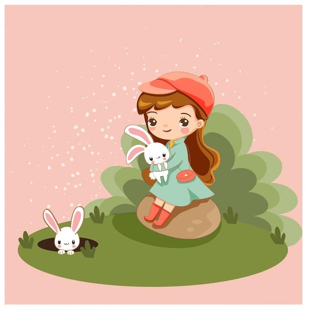 かわいい女の子と彼女のウサギの友達
