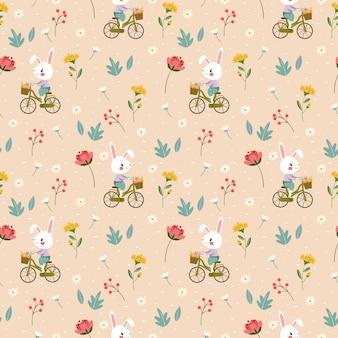 Счастливый кролик на велосипеде среди разнообразных цветов бесшовные модели