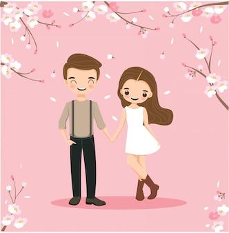 桜の木の下でかわいいカップル