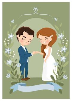かわいいカップルが結婚式の招待カードに結婚指輪を着用