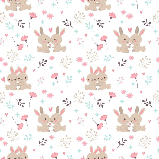 花と葉のシームレスなパターンと恋にかわいいウサギ