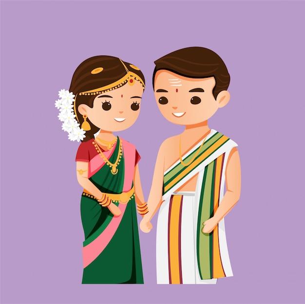 南の結婚式の伝統的なドレスでかわいいインドのカップル