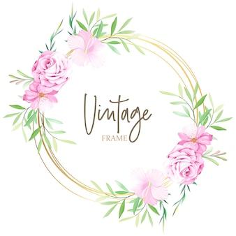 花と葉のフレームを持つエレガントな結婚式のカード