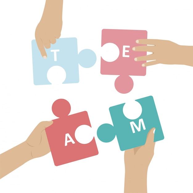 手はパズルを組み立てます。コワーキングとビジネスパートナーシップの概念。パズルの要素をつなぐ人々のチームのメタファー
