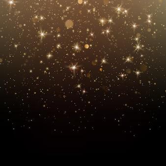 暗い背景にゴールドのきらびやかなスターダスト輝く粒子。