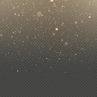 キラキラ粒子オーバーレイ効果。金きらびやかなスターダスト透明な背景に輝く粒子。