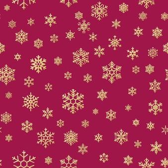 クリスマス雪の結晶のシームレスな繰り返しパターンの背景。