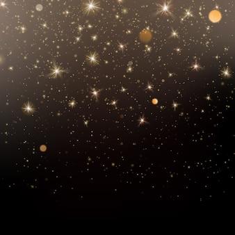 Глиттер золотой светлый блеск эффект черный фон.