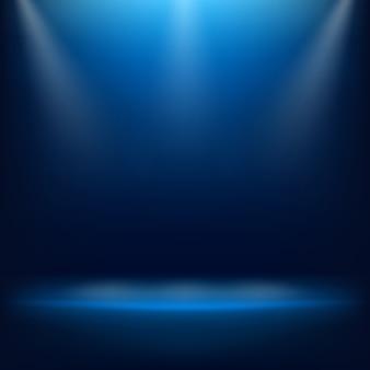 滑らかな濃い青と空のスタジオルームが黒のビネット。ソフトスタジアムアリーナ照明スポットライト。