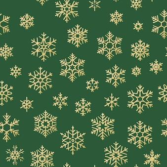シームレスな休日のテクスチャ、テキスタイル、パンフレット、カードのゴールドの雪片の装飾とクリスマスのパターン。