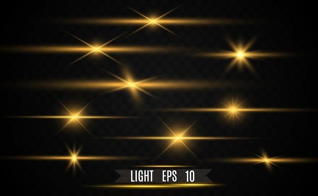 Набор золотых ярких красивых звезд. световой эффект яркая звезда.