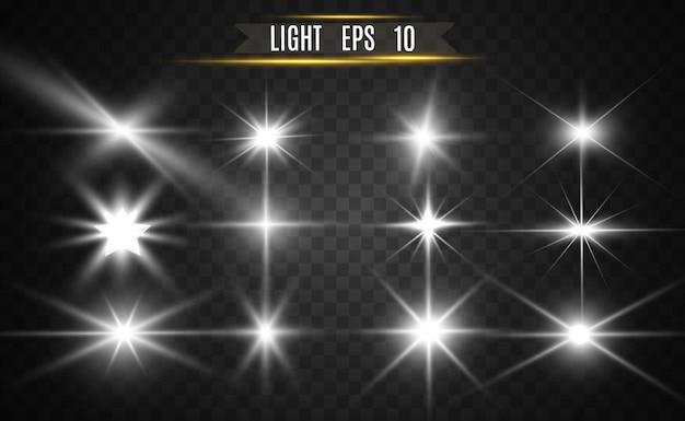 Набор золотых ярких красивых звезд. световой эффект яркая звезда. красивый свет для иллюстрации. векторные блестки. белый светящийся свет.