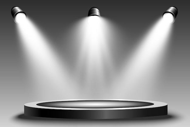 スポットライトで照らされた円形の表彰台、台座またはプラットフォーム。明るい光。上からの光。