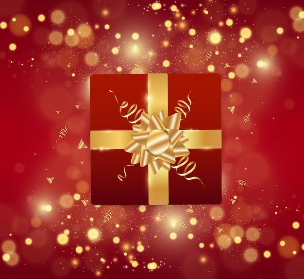 メリークリスマスと新年あけましておめでとうございますお祝いの現実的な赤い背景。ギフトボックスと金色の見掛け倒しの新年イラスト。