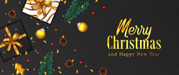 メリークリスマスと新年あけましておめでとうございますバナー。金の紙吹雪、モミのトウヒの葉の花輪、安物の宝石、松ぼっくり、プレゼントボックス。